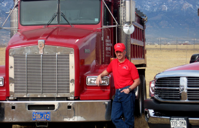 Fred Dullin in front of big red concrete truck